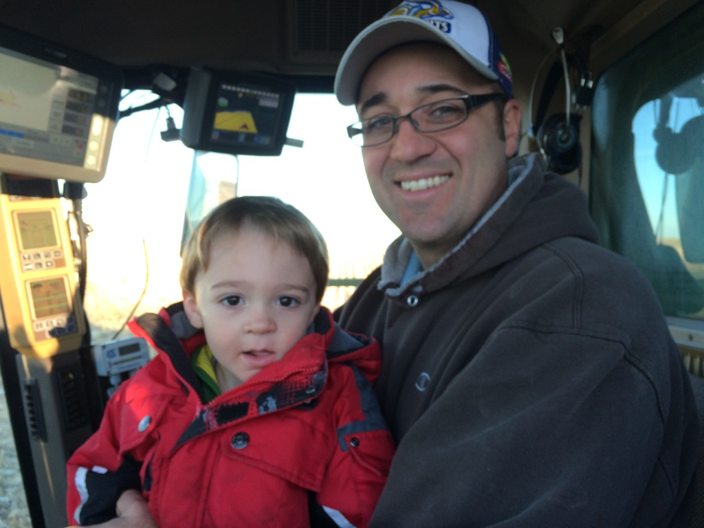 Keith and his son Conner harvesting corn during the fall of 2014.